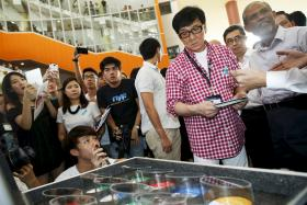 Singapore's new anti-drug ambassador, actor Jackie Chan looks at an exhibit of different types of drugs