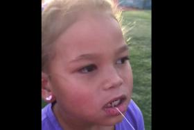 Olympic champion uses javelin skills to remove daughter's tooth.