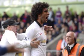 Marouane Fellaini celebrates scoring  Man Utd's second goal