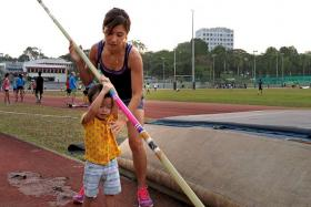 BONDING: For multi-tasker Rachel Yang, bringing her two-year-old son Zacchaeus Yeo to training is the best way to spend time together.
