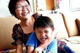HAPPY: (Above) Madam Jessie Ong with her son, Jayden Hee, 6. Madam Ong keeping up with her husband and son. She now walks with a limp.