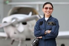 SEEN IT ALL: Miss Tan Shze Ling has come across her fair share of daredevils and immature students during her six years of flight instruction .