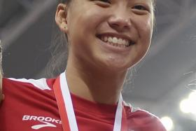 """""""I really didn't expect results so instantly. I've been training hard though, much more compared to before. """" - Eugenia Tan (above), on breaking the long jump record"""