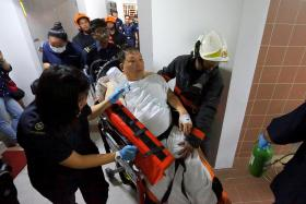 MESS: Mr Poh Chee Keat being taken out by rescuers.