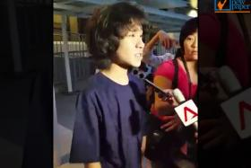 Amos Yee speaks to reporters after exiting the State Courts building.