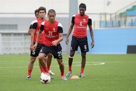 DANGERMEN: LionsXII defender Madhu Mohana (right) and his teammates need to be wary of the threat from Terengganu's Paulo Rangel  and Norshahrul Idlan Talaha.