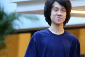 Amos Yee leaving the State Courts on 7 May 2015. The Singaporean teenager has been convicted.