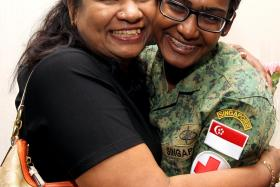 BACK HOME: Military Expert 1 Shorini Dhurgha, 24, a military medical expert, being welcomed home by her mother.
