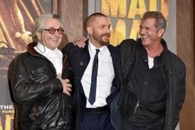 MADCAP: Director George Miller with his two Maxes, Tom Hardy and Mel Gibson.