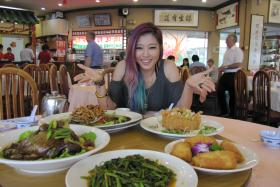 LOCAL DELIGHTS: Ferlyn Wong having lunch at Tan Chin Lee Sea-Fresh Restaurant at Tuas Amenity Centre.