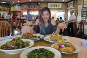 LOCAL DELIGHTS: Ferlyn Wong having lunch at Tan Chin Lee Sea-Fresh Restaurant at Tuas Amenity Centre.