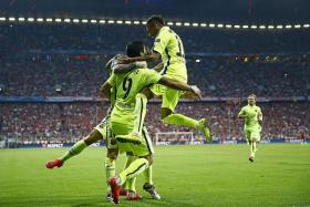 LETHAL CATALANS: The brace by Neymar (right), both set up by Luis SUarez (No. 9), condemned Bayern to another semi-final exit.
