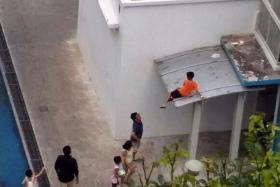 DRAMATIC: After retrieving his ball from the second-storey ledge, the boy tried to lower himself to the first storey but decided against it as it was too high. So he climbed back up to the third storey.
