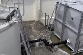 FILE PHOTO: Condo residents were appalled there's a corpse in their water tank - and they've been drinking from it for a week.