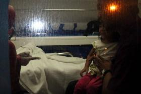 Medical staff look after one of the girls who was held hostage.