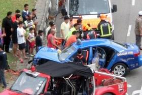 TRAGIC: The ComfortDelGro taxi crashed at Pasir Ris Drive 3 on Saturday. It crashed into a car before ramming into a tree.