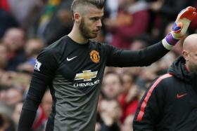 BYE, BYE? David de Gea waving to Man United's fans after yesterday morning's 1-1 draw with Arsenal at Old Trafford.
