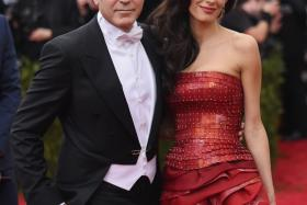 TEQUILA SURPRISE: George Clooney in formal wear at an event last month, a far cry from his favourite tequila T-shirt promoting his business, a dress sense Mrs Amal Clooney often questions him about.