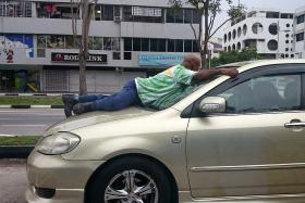 Mr Haresh Govindaraju clinging on to the car's windscreen