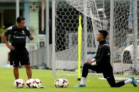 MENTOR: LionsXII goalkeeping coach Lee Bee Seng (left) says Izwan Mahbud (right) has become better at communication with his teammates.