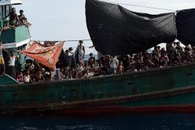 Rohingya migrants on a boat drifting in Thai waters off the southern island of Koh Lipe in the Andaman last Thursday. Trafficking experts say Thailand is the centre of a multimillion dollar trade run by competing transnational criminal syndicates.