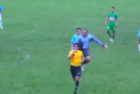 When kungfu and football mix: Goalkeeper Paolo Insua unleashed a lightning-fast kick on the referee.