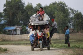Rohingya Muslims ride a vehicle as they travel outside Sitttwe, Myanmar