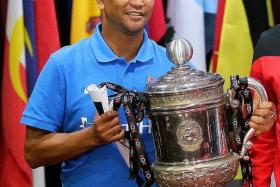 """Don't worry. We hold it now, we'll take it home tomorrow."" - Unlike his counterpart Azraai Khor Abdullah, Fandi Ahmad (above) is not afraid of falling victim to the jinx of touching the trophy before a final"