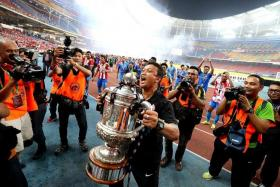 EMOTIONAL: Fandi with the Malaysian FA Cup (above) and his late father Ahmad Wartam (below).