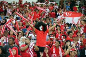ROAR: The Singaporean fans making themselves heard at the Bukit Jalil Stadium last night.
