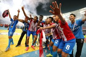 WHAT A FEELING: The LionsXII players paying tribute to the travelling fans.