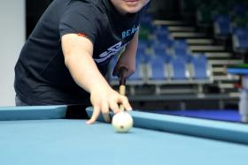 """The SEA Games will definitely be tough, but I'm going for gold."" - Aloysius Yapp (above), who is taking part in the nine-ball singles and doubles events"
