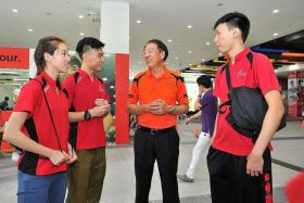 PEP TALK: Deputy Prime Minister Teo Chee Hean (centre) chatting with SEA Games- bound athletes, including Cheryl Lim (far left), at the luncheon yesterday.