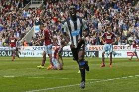 SAVIOUR: Newcastle's Moussa Sissoko celebrating after scoring his team's first goal.