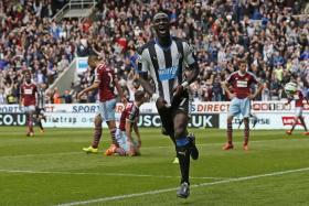 SAVIOUR: Newcastle's Moussa Sissoko celebrating after scoring his team's first goal.