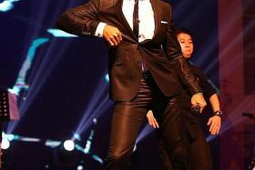 NEWLYWED: Taufik Batisah performing at Jamiyah Singapore's charity concert at Resorts World Ballroom at Sentosa.