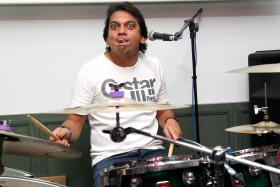 FOLLOW MY BEAT: Former national midfielder Rafi Ali (above) showing his support for the national Under-23 football team with his band's rendition of The Beatles' Come Together.