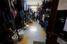 CRAMPED: This room houses 40 foreign workers