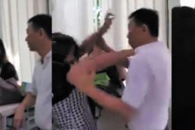 Screengrabs from the video showing twin sisters Tang Bei and Tang Lei arguing with condominium manager Colvin Quek at Simei Green Condominium.