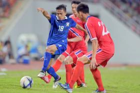 BOOST: Chanathip Songkrasin (No. 18), one of Thailand's stars when they won the Suzuki Cup last year, will be spearheading their SEA Games campaign.
