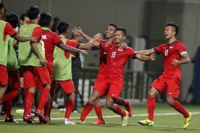 Sheikh Abdul Hadi  celebrates scoring against Philippines