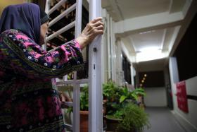 SPAT: Madam Himadah Hamid (above) has been accused of excessive cooking by her neighbours.
