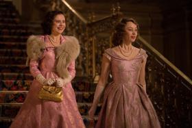 Sarah Gadon (R) plays Princess Elizabeth with Bel Powley (L) as Princess Margaret