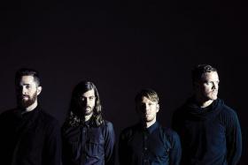 ON FIRE: US rock band Imagine Dragons with (from left) Daniel Platzman, Daniel Wayne Sermon, Ben McKee, Dan Reynolds.
