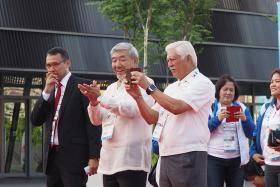 PHILIPPINES: Chef de mission Julian Camacho (centre) with Ricardo Garcia (right), chairman of the Philippine Sports Commission, at the welcome ceremony.