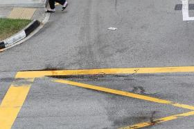 ACCIDENT SCENE: Bloodstains on the road where the elder Mr Ng was knocked down.