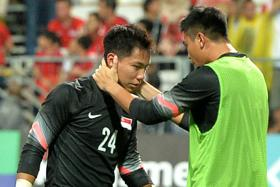 SAD DAY: Goalkeeper Syazwan Buhari is consoled by teammate Rudy Khairullah after the loss.