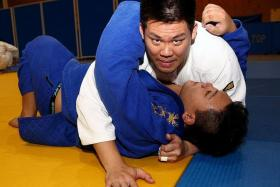 """""""Pui Seng is in a good position and we hope he can win gold."""" - National judo coach Low Chee Kiang on judoka Wee Pui Seng (above, in white)."""