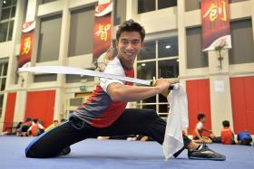DREAM COMES FIRST: (Above) Wushu athlete Yong Yi Xiang, who deferred his place in NUS Law to train full time for the SEA Games.