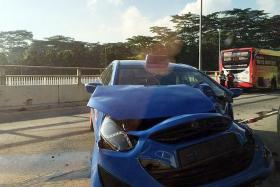 AFTERMATH: The SMRT bus and ComfortDelGro taxi  (above) involved in the crash.